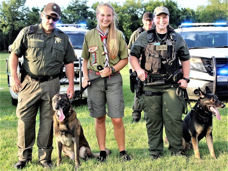 (L-R)  K-9 Sgt. Lee Young, K-9 Eli, Eagle Scout candidate Taylor, K-9 Deputy Brad Harwell, K-9 Deputy Sarah Blair and K-9 Appie and Eli